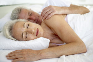 mature man and woman in bed