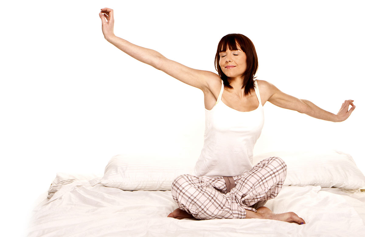 Happy woman stretching after a good nights sleep